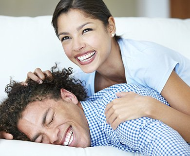 Man and woman waking feeling rested thanks to snoring solutions in Orange, California