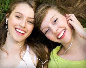 Two young women smiling after wisdom tooth extraction in Orange California