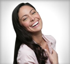 Patient with straightened smile after Invisalign clear braces in Orange California