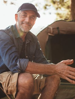 Man with full smile thanks to dental implants in Orange California