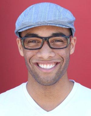 Man smiling after receiving dental crowns in Orange California