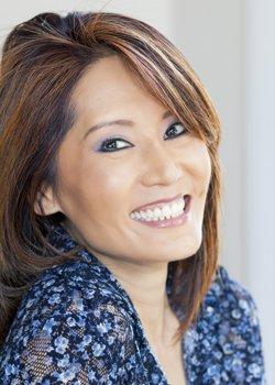 Woman smiling after gum disease treatment in Orange California