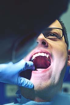 man getting a dental exam